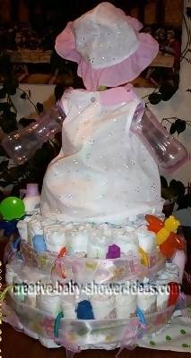 back of sunflower doll diaper cake sitting on 2 tier diaper cake