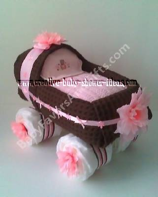 brown and pink baby buggy diaper cake