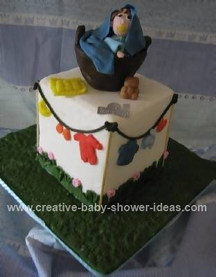 basket and baby with baby shower clothes cake