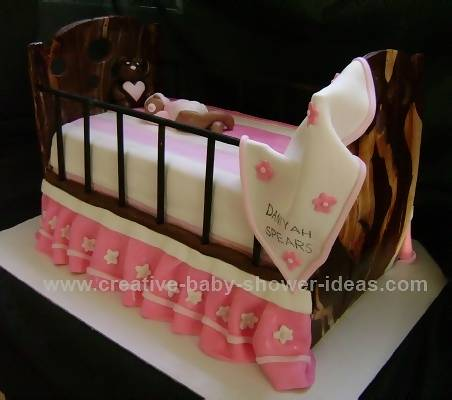pink and white baby crib cake