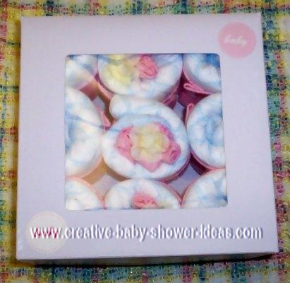 9 mini baby diaper cupcakes in a a gift box