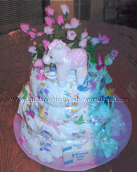3 tier pink elephant diaper cake with pink roses