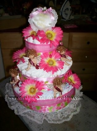 pink gerbera daisy and angel diaper cake