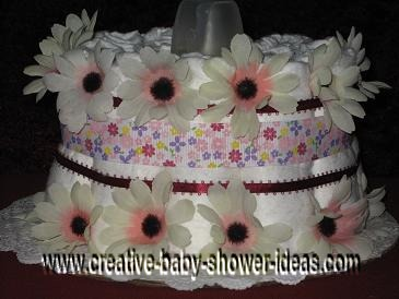 pink and purple daisies diaper cake