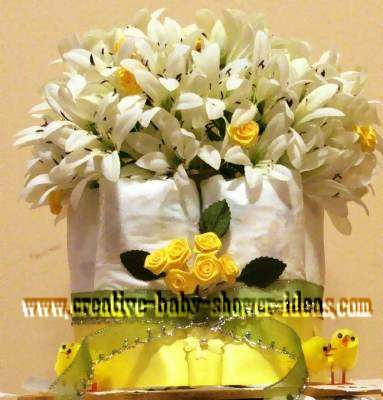 top of chic diaper cake with white flowers