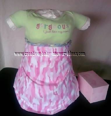 baby diaper cake with green onesie and pink cameoflauge skirt