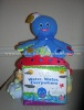 baby einstein themed diaper cake with blue octopus on top and book infront