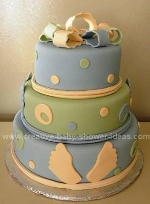 blue and green footprint baby cake