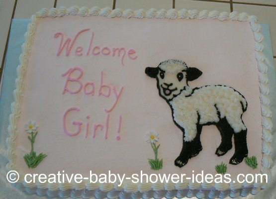 white sheet cake with baby lamb design