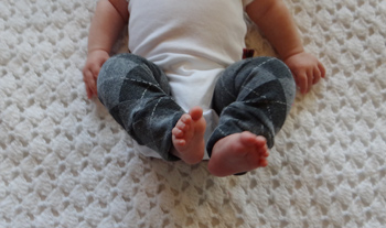 a 3 month old baby wearing finished infant baby leg warmers