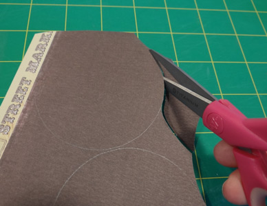 scissors cutting out circles in paper