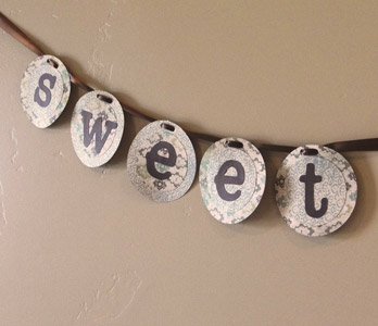 finished baby shower banner with closeup on the word sweet