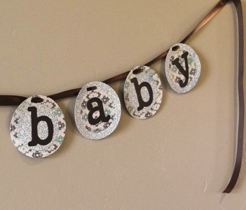 finished baby shower banner with closeup on the word baby