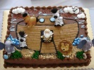 sheetcake designed to look like noahs ark with fisher price animal toys on it