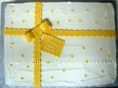 yellow and white polka dot present cake tied with a bow