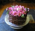 chocolate basketweave cake filled with pink flowers