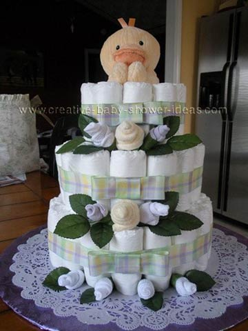 pastel sock roses and yellow duck diaper cake