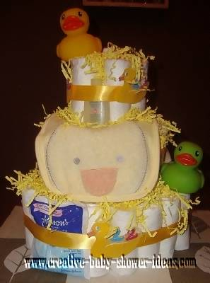 yellow duck baby shower diaper cake with paper shred