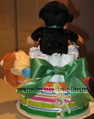 green stripes monkey diaper cake showing bow