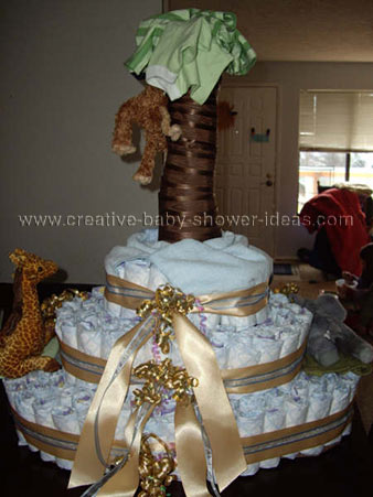 side of monkey diaper cake showing gold ribbon bows