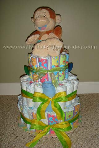front of giggling monkey diaper cake