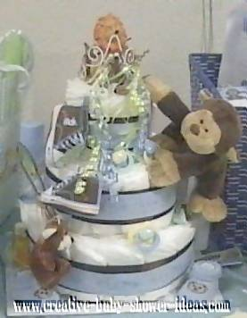 blue and brown monkey baby shower diapers cake