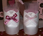 styrofoam cups cut and glued to create a baby bootie favor with treats inside