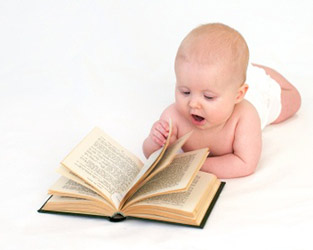 surprised baby reading book