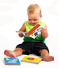 baby boy reading colorful books