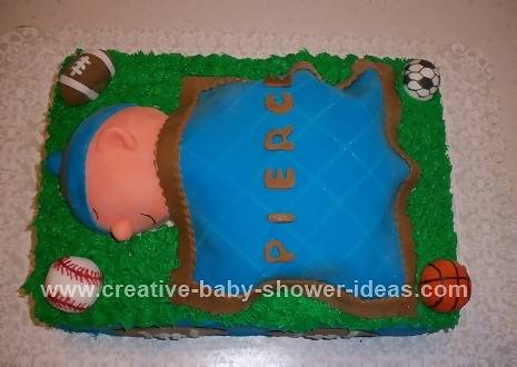 baby sleeping on green field with blue and brown blanket and sports balls