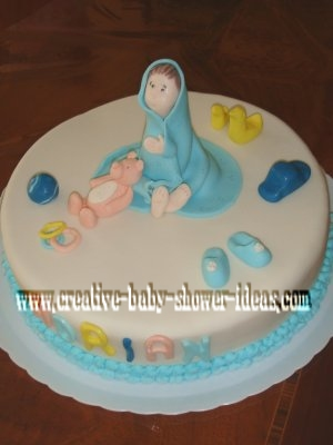 baby in a blue blanket cake