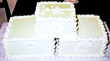 cream and white blocks baby shower cake