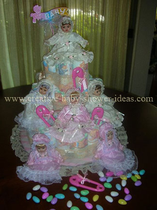 closeup of porcelian dolls on diaper cake