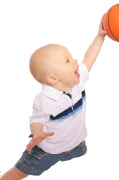 baby in the air shooting a basket with a basketball