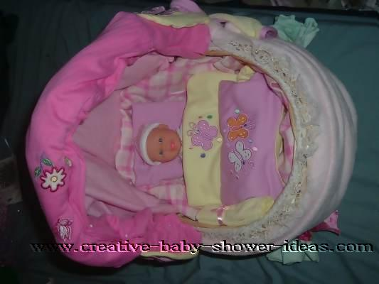 top view of basket baby carriage with doll
