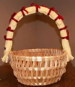 basket top tied with red ribbon