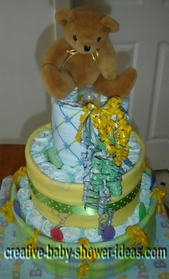 yellow and green bear diaper cake