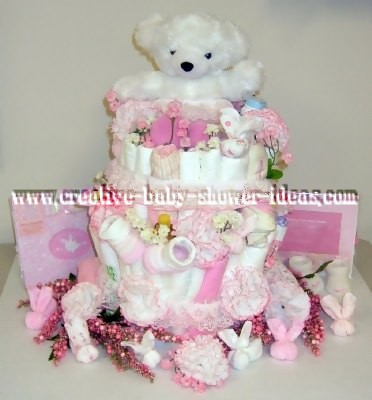 white and pink bear diaper cake