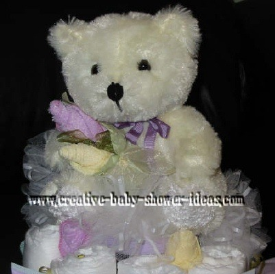 closeup of ballerina bear and sock roses on diaper cake