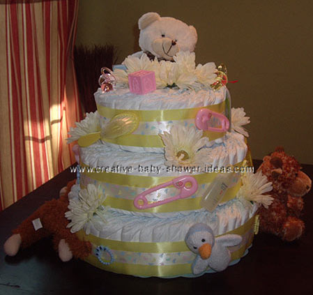pink and yellow teddy bear diaper cake