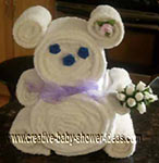 white towel bear with blue rosette eyes