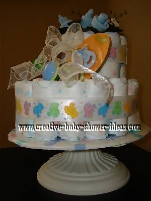right side of baby bootie cake with baby sock roses