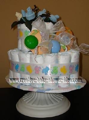 baby sock baby bootie cake on white cake stand