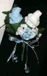white and blue sock rose boutonniere