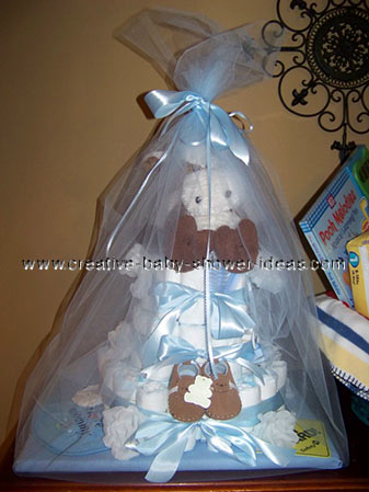 brown and blue boy diaper cake wrapped in tulle