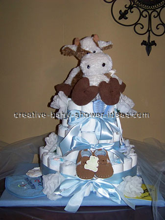 brown and blue cow diaper cake