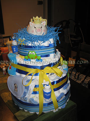 yellow and blue piggy bank diaper cake