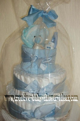 boy teddy bear diaper cake wrapped in cellophane