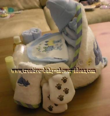 side of towel cupcake showing baby clothing