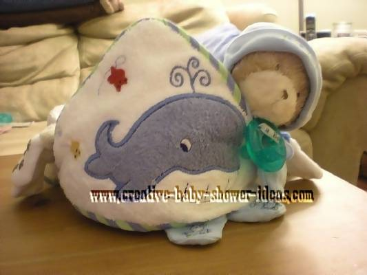front of blue towel cupcake with teddy bear and pacifier
